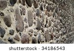 the stone wall with shallow DOF - stock photo