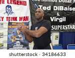 Постер, плакат: WWE Wrestler Virgil signs