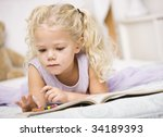 a young girl is laying on a bed ... | Shutterstock . vector #34189393