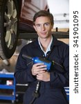 Small photo of Car Mechanic Holding Air Hammer