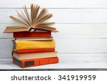 open book  stack of colorful... | Shutterstock . vector #341919959