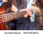 aggressive play guitar on stage | Shutterstock . vector #341982851