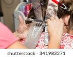 weave hair in a beauty salon | Shutterstock . vector #341983271