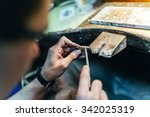 Small photo of Jewelery polishing ring in workshop with adequate tools