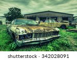 wrecked american cars at an...