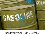 store of well used gasoline fuel drums - stock photo