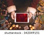 Santa Claus Using A Digital...