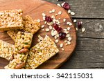 muesli bars on old wooden table | Shutterstock . vector #342115031