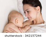 mom and sleeping baby on the... | Shutterstock . vector #342157244