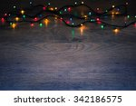 christmas lights on wood... | Shutterstock . vector #342186575