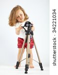 Little Girl With Tripod On Gra...