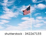 American Flag Waving Under A...