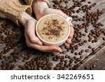 woman holding hot cup of coffee | Shutterstock . vector #342269651