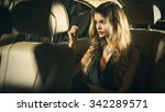 young blond woman sitting on a... | Shutterstock . vector #342289571