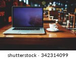 open laptop computer and cup of ... | Shutterstock . vector #342314099