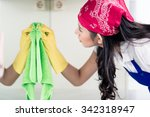 Asian Homemaker Cleaning The...