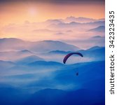 Paraglide Silhouette In A Ligh...