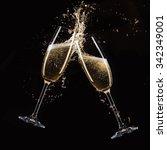 glasses of champagne with splash | Shutterstock . vector #342349001