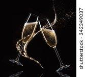 glasses of champagne with splash | Shutterstock . vector #342349037