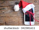 smart phone with christmas hat | Shutterstock . vector #342381611