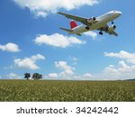 Small photo of Aircraft taking off over a scenic wheat field