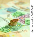 coins on euro banknotes. | Shutterstock . vector #34250491