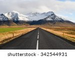 empty road leading to snow... | Shutterstock . vector #342544931