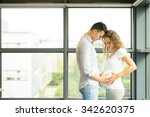 happy and young pregnant couple ... | Shutterstock . vector #342620375