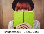 Hipster Woman Behind A Book...