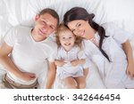 happy family lying on a bed... | Shutterstock . vector #342646454
