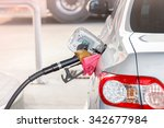 hand hold fuel nozzle to add... | Shutterstock . vector #342677984