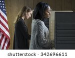 Two Young Adult Women Voting I...