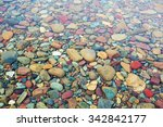 Colorful Stones Under The Clea...