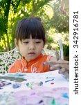 little girl painting in garden... | Shutterstock . vector #342916781