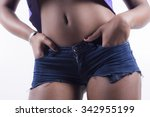 Black woman jeans shorts closeup with hands in the pocket - stock photo