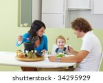 happy family eating meat fondue ...   Shutterstock . vector #34295929