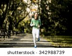 young woman running in the park | Shutterstock . vector #342988739