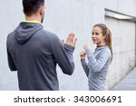 Small photo of fitness, sport, martial arts, self-defense and people concept - happy woman with personal trainer working out strike outdoors