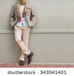 fashionable man in beige... | Shutterstock . vector #343041401