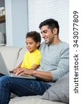 smiling father and son using... | Shutterstock . vector #343077809