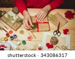 girl sits at the table wraps... | Shutterstock . vector #343086317