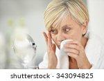 senior woman in bathroom... | Shutterstock . vector #343094825