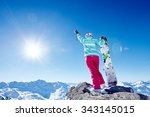 back view of female snowboarder ... | Shutterstock . vector #343145015
