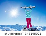 back view of female snowboarder ... | Shutterstock . vector #343145021