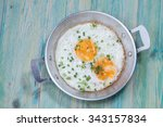 egg in pan on wood table | Shutterstock . vector #343157834