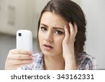 Small photo of Teenage Girl Victim Of Bullying By Text Message