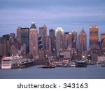 This is a view of the New York City skyline and pier in the early evening. - stock photo