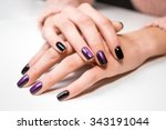 hand on hand with nice manicure.... | Shutterstock . vector #343191044