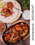 pork fajitas with onions and... | Shutterstock . vector #343196147
