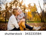 happy woman and her little son... | Shutterstock . vector #343233584